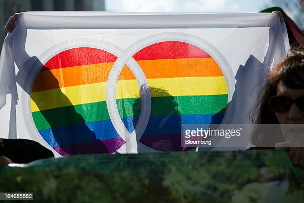 A supporter of samesex marriage holds a rainbow flag outside the US Supreme Court in Washington DC US on Tuesday March 26 2013 The Supreme Court...
