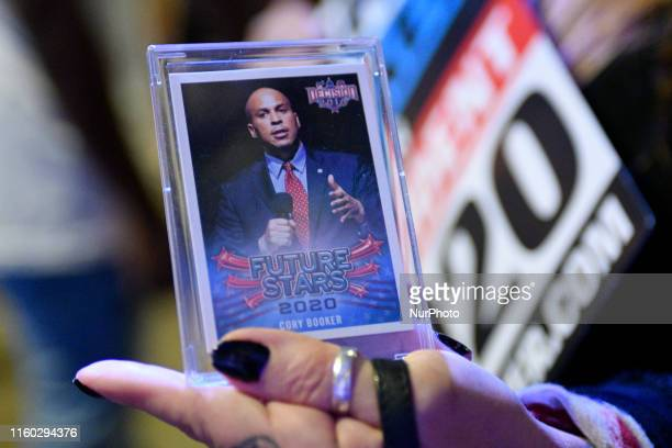 A supporter of Sen Cory Booker holds up a card ahead of a Philadelphia Rise rally at the Fillmore in Philadelphia PA on August 7 2019
