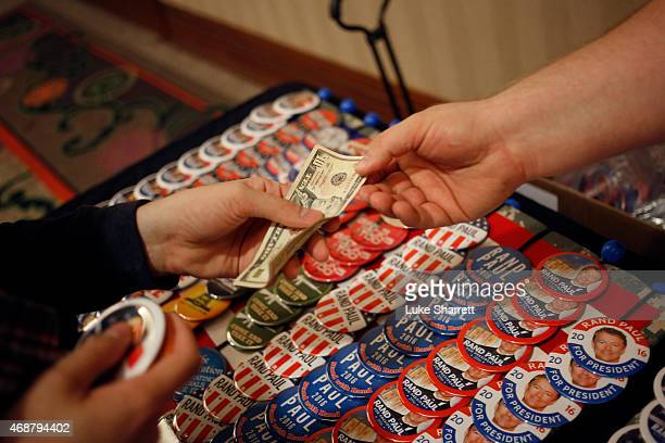 A supporter of Sen Rand Paul purchases campaign buttons before an event at which Paul will announce his candidacy for the Republican presidential...