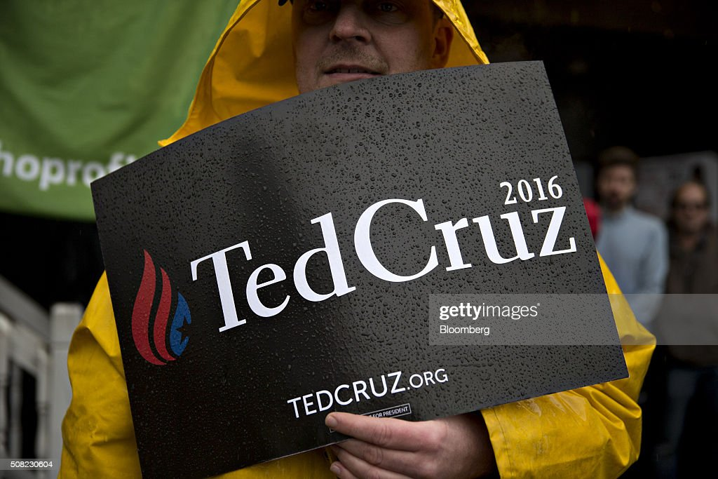 A supporter of Senator Ted Cruz, a Republican from Texas and 2016 presidential candidate, stands in the rain as while holding a sign before Senator Ted Cruz, a Republican from Texas and 2016 presidential candidate, not pictured, makes a campaign stop at the Village Trestle in Goffstown, New Hampshire, U.S., on Wednesday, Feb. 3, 2016. Republican presidential candidate Donald Trump on Wednesday said Cruz 'stole' first place in the Iowa caucuses and called for 'a new election' or nullification of Cruz's win. Photographer: Andrew Harrer/Bloomberg via Getty Images