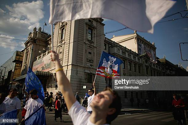 A supporter of Serbia's proWestern president and Democratic Party leader Boris Tadic wave Serbian and EU flags during a preelection rally on May 7...