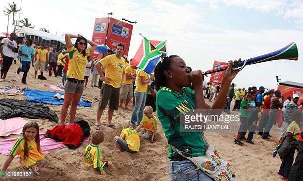 A supporter of South Africa plays while hundreds of colourful fans from all over the world descend on the Fanfest at the New North Beach in Durban on...