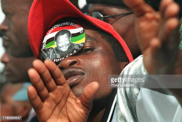 A supporter of South African Inkata Freedom Party sporting a sticker of its leader Prince Mangosuthu Buthelezi on forehead poses 09 May 1999 during...