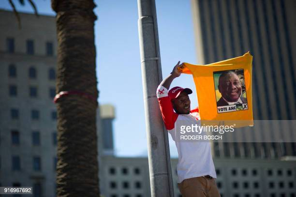 Supporter of South Africa's ruling African National Congress holds up a shirt featuring newly-elected ANC president and South African Deputy...