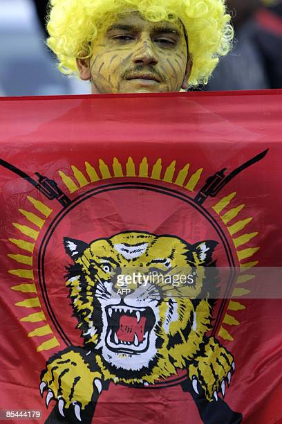 A supporter of Sri Lanka's Tamil Tiger rebels holds a Tamil Tiger flag during a demonstration on March 16 2009 in Geneva demanding peace in SriLanka...