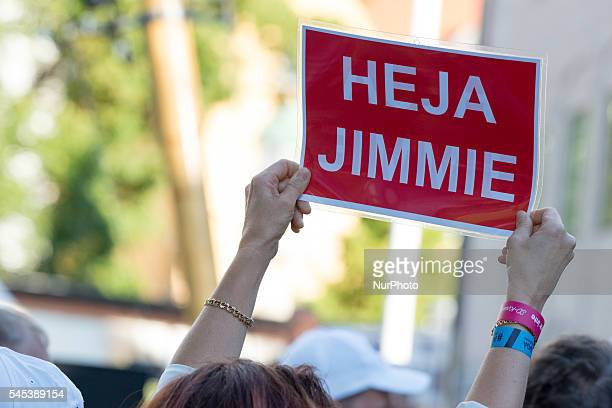 A supporter of Sweden Democrat leader Jimmie Åkesson holds a sign reading quotGo Jimmiequot during Åkesson's speech at Almedalen Week in Visby on...