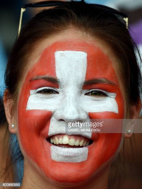 A supporter of Switzerland looks on with her face painted as the Swiss national flag during the UEFA Womens Euro 2017 football tournament match...