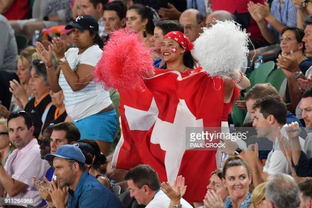 A supporter of Switzerland's Roger Federer waves a national flag during his men's singles final against Croatia's Marin Cilic on day 14 of the...