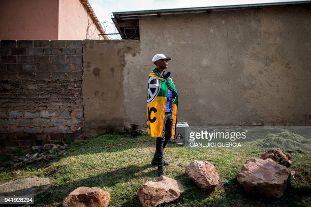 A supporter of the African National Congress looks on as members of the Women's League rally outside the home of the late South African antiapartheid...