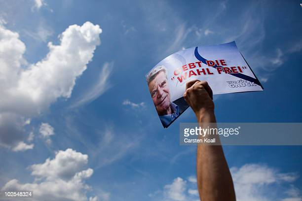 A supporter of the candidate Joachim Gauck holds up a poster during the election of a new German president by the Federal Assembly at Reichstag the...