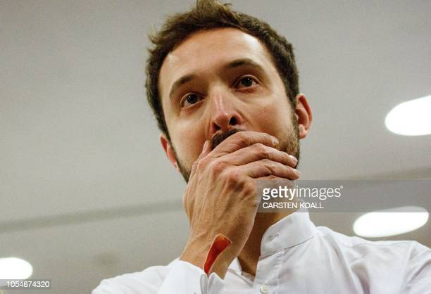 Supporter of the Christian Democratic Union reacts as first exit polls were announced on public television during the state elections in Hesse at the...