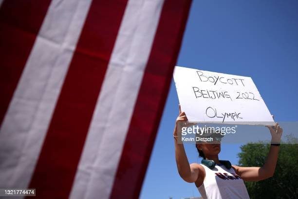 Supporter of the East Turkistan National Awakening Movement participate in a rally calling on the U.S. Government to support and recognize the group...