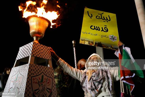TOPSHOT A supporter of the Fatah movement attends a celebration at the tomb of the late President Yasser Arafat marking the fiftythird anniversary of...