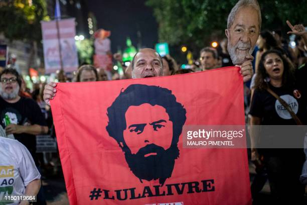 A supporter of the former Brazilian president Luis Inacio Lula da Silva holds a flag during a national strike protest called by unions and students...