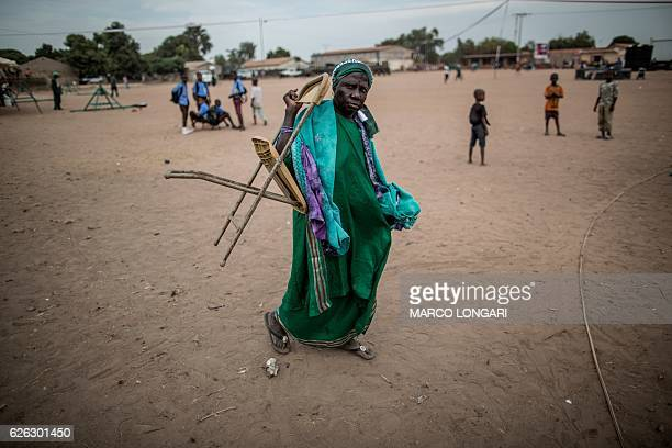 Supporter of the Gambian incumbent president Yahya Jammeh, dressed in green, the colour of the president's party The Alliance for Patriotic...