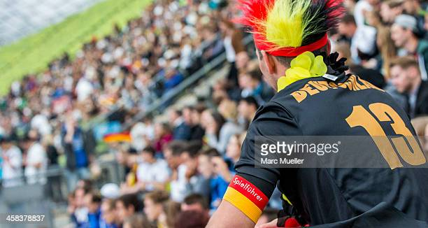 Supporter of the German national soccer team poses during the UEFA EURO 2016 match between Germany and Italy at the public viewing area in the...