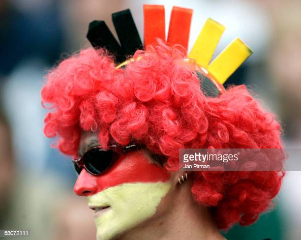 A supporter of the German National team is dressed in the German colors black red and gold before the FIFA Confederations Cup 2005 match between...