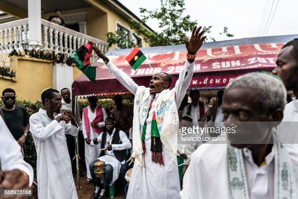 A supporter of the Indigenous People of Biafra has a Biafran flag sticked to his forehead as he joins members of the Yahveh Yashua Synagogue...