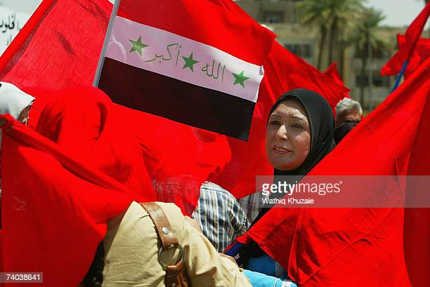 A supporter of the Iraqi Communist Party is seen during a May Day celebration May 1 2007 in Baghdad Iraq May Day was inspired by a wave of strikes...