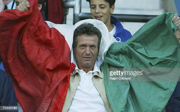 A supporter of the Italien team poses with a flag prior to the Italy v Serbia and Montenegro match in the UEFA European Under 21 Championships at the...