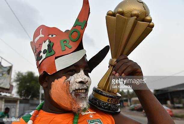 A supporter of the Ivorian national team poses on February 8 2015 in Abidjan before the 2015 Africa Cup of Nations football final in Equatorial...