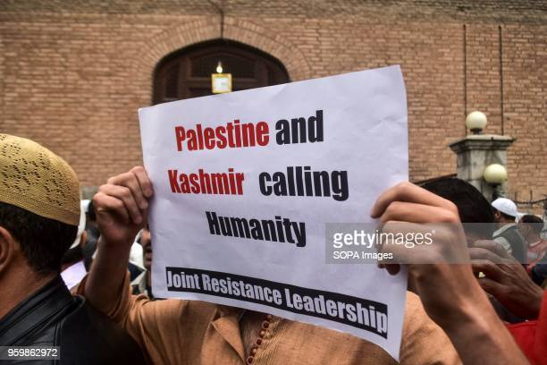 A supporter of the Joint Resistance Leadership holds a placard during a protest in Srinagar Indian administered Kashmir A large number of protesters...
