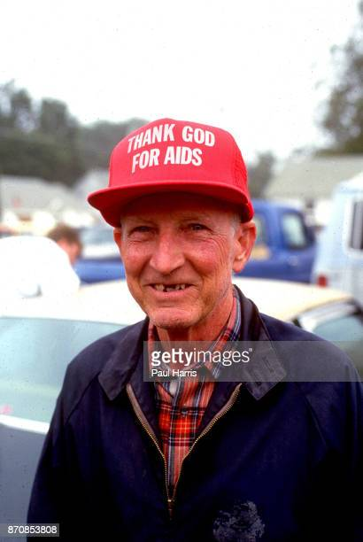 A supporter of the Ku Klux Klan wears a hat thanking god for AIDS May 4 Stone Mountain Georgia