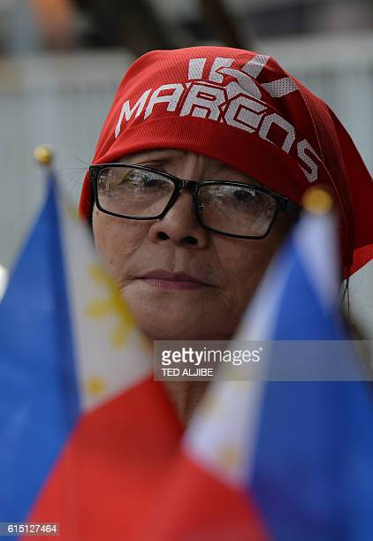 A supporter of the late dictator Ferdinand Marcos waits for the arrival of his daughter Imee Marcos governor of the family's northern stronghold of...