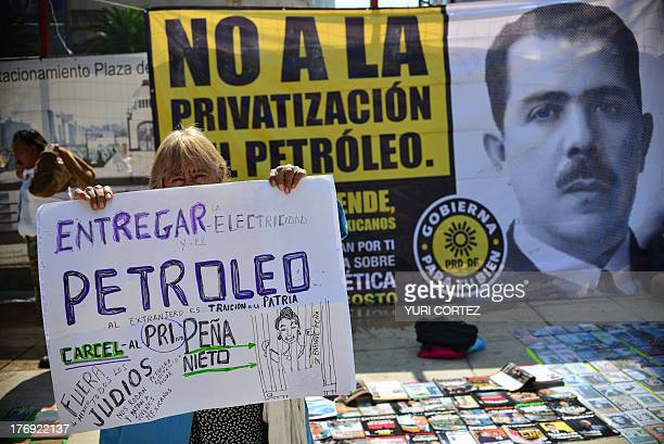 A supporter of the leftwing Party of the Democratic Revolution shows a banner against a constitutional reform proposed by Mexican President Pena...