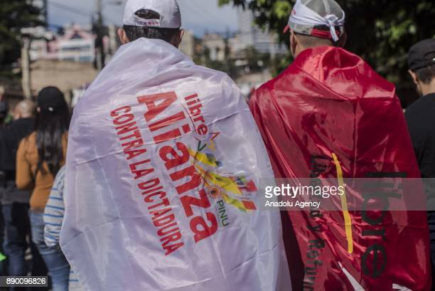 A supporter of the 'Libertad y Refundacion' party and a supporter of presidential candidate for Honduras' Opposition Alliance against Dictatorship...