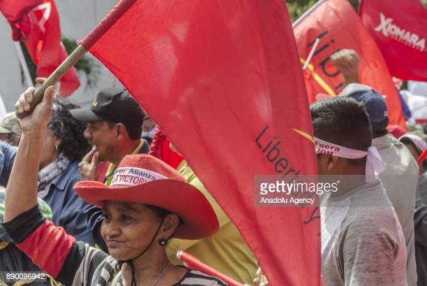 A supporter of the 'Libertad y Refundacion' party takes part in a protest against current president Juan Orlando Hernandez for illegally running for...