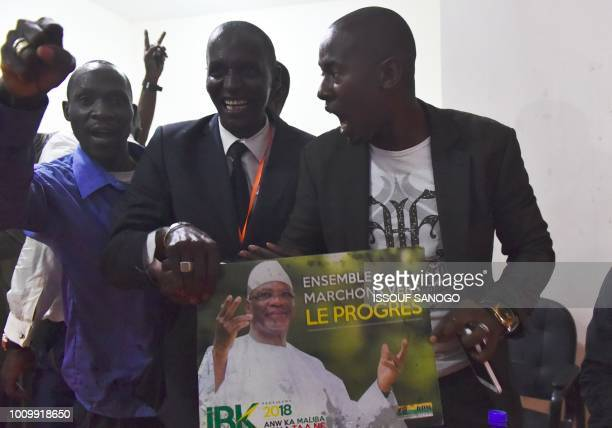 A supporter of the Malian outgoing presidential Ibrahim Boubacar Keita celebrates at the campaign headquarter after the announcement of the results...