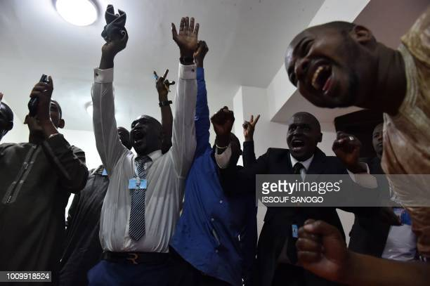 A supporter of the Malian President Ibrahim Boubacar Keita celebrates after the announcement of results of the first round of the presidential...