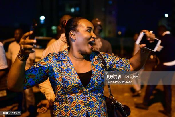 A supporter of the Malian presidential candidate and opponent Soumaila Cisse reacts on the street after he announcement of the results of the first...