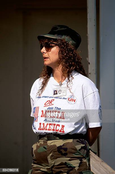 A supporter of the Michigan Militia wears her sentiments on her shirt as she listens to conservative speakers at an outdoor rally