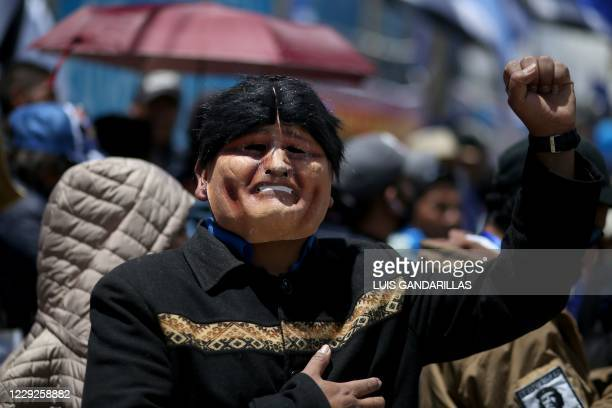 Supporter of the Movimiento Al Socialismo party, disguised as former President Evo Morales, celebrates Bolivian leftist presidential candidate Luis...