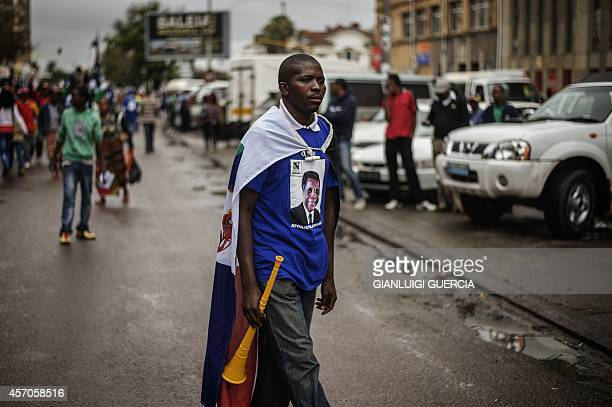 A Supporter of the Mozambican Resistance Movement 's candidate for the presidential election Alfonso Dhalakama takes part in a motorcade campaign...