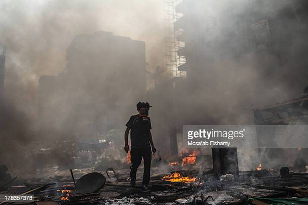 CONTENT] A supporter of the Muslim Brotherhood and Egypt's ousted president Mohamed Morsi is seen amidst the rubble during clashes with police in...