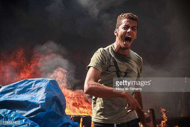 CONTENT] A supporter of the Muslim Brotherhood and Egypt's ousted president Mohamed Morsi is seen during clashes with police in Cairo on August 14 as...