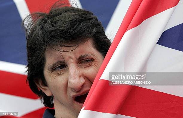 A supporter of the National Front yawns as he waits for members of the radical Islamic group AlMuhajiroun to arrive at their proposed meeting in...