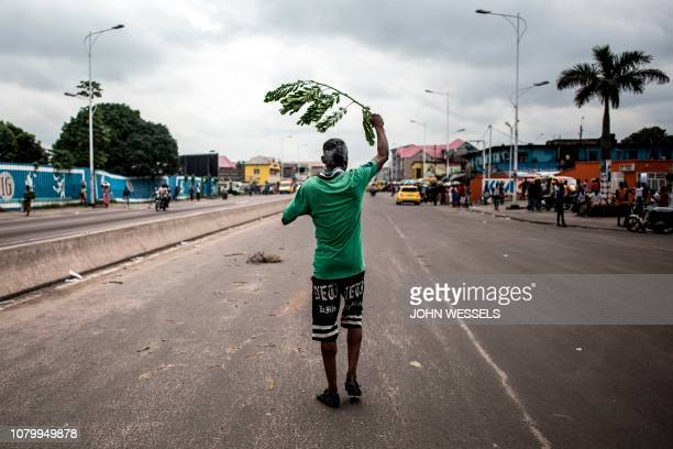 A supporter of the newly elected president of the Democratic Republic of Congo Felix Tshisekedi celebrates in the streets on January 10 2019 in...