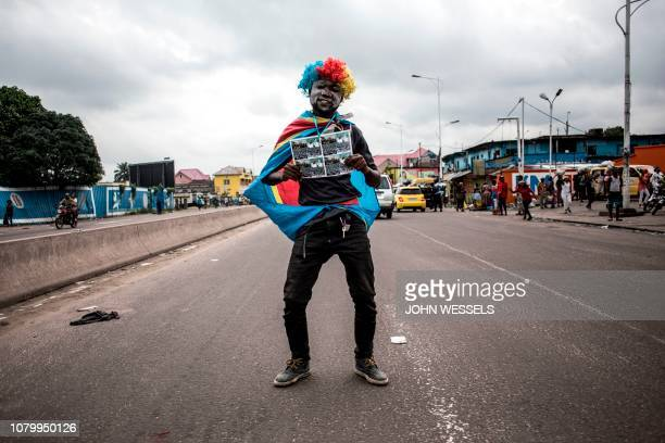 TOPSHOT A supporter of the newly elected president of the Democratic Republic of Congo Felix Tshisekedi celebrates in the streets of Kinshasa on...