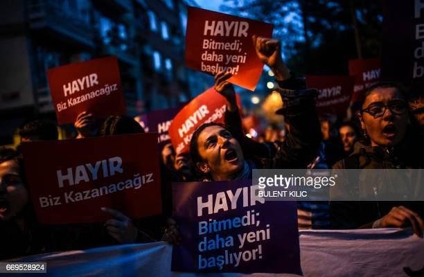 """Supporter of the """"No"""" gestures and chants slogans as he holds a placard reading """"No"""" during a march at the Kadikoy district in Istanbul on April 17,..."""