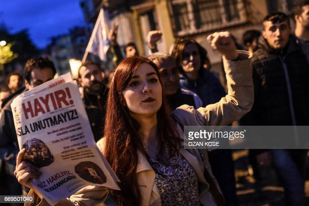 """Supporter of the """"No"""" holds a leaflet reading """"no"""" as she gestures while she takes part in a gather at the Besiktas district in Istanbul on April 17,..."""