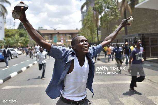 TOPSHOT A supporter of the oppositionled National Super Allince gestures and holds stones in Nairobi on October 11 2017 during street protests by...