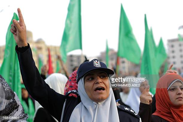A supporter of the Palestinian Islamic group Hamas raises up her finger during a festival of the International Association of Muslim Scholars head by...