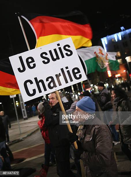 A supporter of the Pegida movement carries a sign that reads in French 'I am Charlie' as a symbol of solidarity with the victims of the recent Paris...