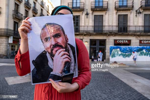 Supporter of the Popular Rif Movement is seen showing a placard with the portrait of a Rifian activist during the rally. Sympathizers of the Popular...