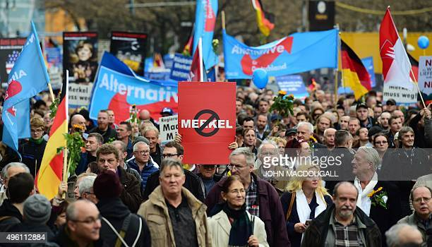 A supporter of the rightwing populist Alternative for Germany party displays an antiMerkel placard during a demonstration against the German...