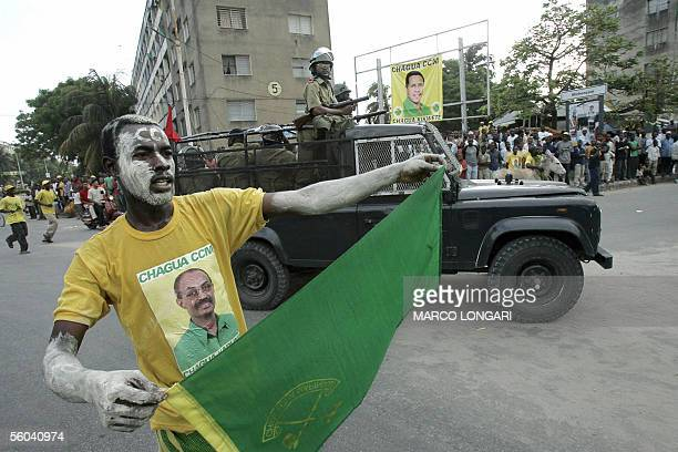 A supporter of the ruling Revolutionary party celebrate the victory of their leader Amani Abedi Karume 01 November 2005 in the presidential elections...